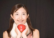 Smiling woman holding apple