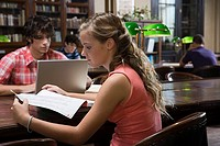 Teenagers studying in library