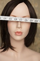 Mannequin with tape measure over eyes
