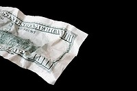 A crumpled one hundred dollar note