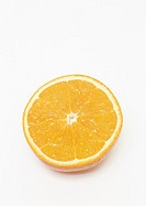 Halved orange on white background