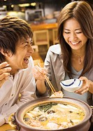 Couple Eating Japanese Style Chowder