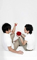 Man and woman with a bowl of strawberries