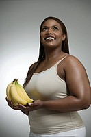 Woman holding bananas