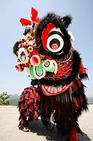 Performers in black and red lion costume
