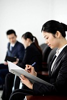 Businesswoman with pen and document