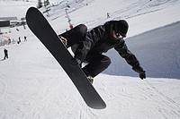 Snowboarder Riding a Half-Pipe (thumbnail)