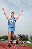 Man upon reaching finishing line