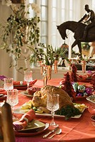 Elegant holiday table setting with roast turkey