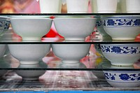 fresh home made yogurt is kept hygienic in small bowls in a market in Xining , Quinhai province , China