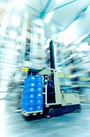 Blurred motion view of worker on forklift inside warehouse, Weingarten, Baden_Wurttemberg, Germany
