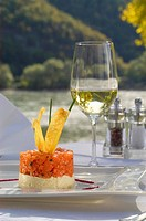 Close_up of wineglass with food served on platter