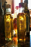 Close_up of bottles of olive oil