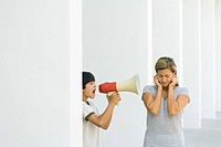 Boy screaming at mother through megaphone