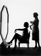 Two women in front of a large mirror All persons depicted are not longer living and no estate exists Supplier warranties that there will be no model r...