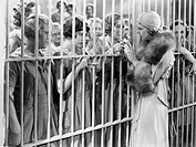 One woman standing in front of a jail talking with a group of women All persons depicted are not longer living and no estate exists Supplier warrantie...