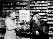 Two women in a drug store looking at each other All persons depicted are not longer living and no estate exists Supplier warranties that there will be...