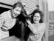 Two women fighting and pulling each others hair All persons depicted are not longer living and no estate exists Supplier warranties that there will be...