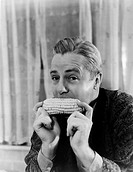 Portrait of a man eating a corn cob All persons depicted are not longer living and no estate exists Supplier warranties that there will be no model re...