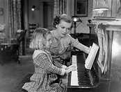 Piano lesson All persons depicted are not longer living and no estate exists Supplier warranties that there will be no model release issues