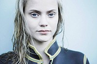 Portrait of young woman in wet suit