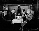 Picking up the tab in train dining car All persons depicted are not longer living and no estate exists Supplier warranties that there will be no model...