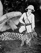 Female hunter with dead leopard All persons depicted are not longer living and no estate exists Supplier warranties that there will be no model releas...