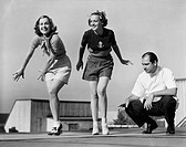 Man coaching two female dancers All persons depicted are not longer living and no estate exists Supplier warranties that there will be no model releas...