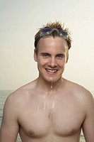 Portrait of wet male swimmer