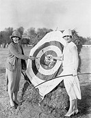 Women with bulls eye in archery target All persons depicted are not longer living and no estate exists Supplier warranties that there will be no model...