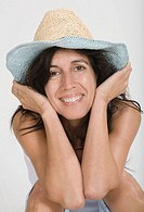 Woman smiling with a hat