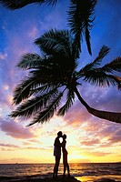 Couple at the beach, sunset