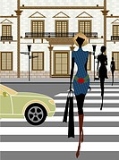 Woman crossing a road at zebra crossing