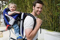 Father carrying son in backpack