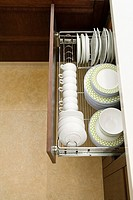 High angle view of potteries in a kitchen cabinet