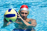 Portrait of a mid adult man playing water polo in a swimming pool
