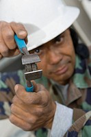 Portrait of a mature man holding a wire cutter (thumbnail)
