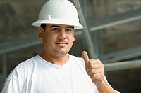 Portrait of a male construction worker showing a thumbs up sign