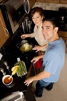 High angle view of a mid adult man with his mother in the kitchen