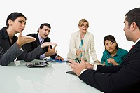 Five business executives discussing in a meeting