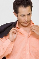 Close-up of a businessman blowing in a shirt