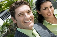 Portrait of a businessman smiling with a businesswoman