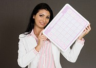 Close-up of a businesswoman holding a calendar