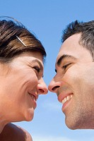 Close-up of a mid adult couple looking at each other with smiling