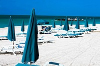 Lounge chairs and beach umbrellas on the beach, Fort Zachary Taylor State Park, Key West, Florida, USA
