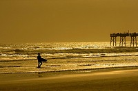Silhouette of a person walking on the beach, Daytona Beach, Florida, USA