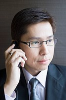 Businessman listening to cell phone