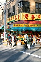 Group of people in a fruit market, Chinatown, Manhattan, New York City, New York State, USA
