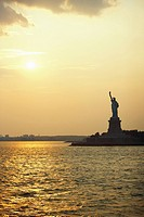 Silhouette of a statue at dusk, Statue Of Liberty, New York City, New York State, USA