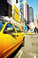 Yellow taxi on a road, Times Square, Manhattan, New York City, New York State, USA